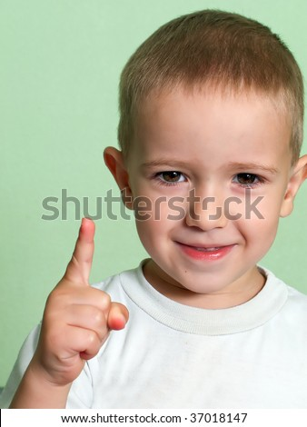 Little human child shake finger for threat warning - stock photo