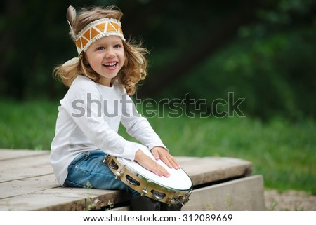 little Indian girl plays the tambourine - stock photo