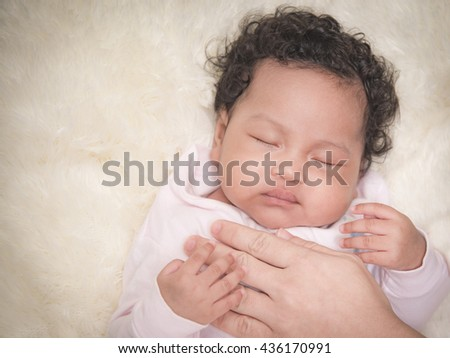 Little infant mix rate asian african close up 4 months old - stock photo