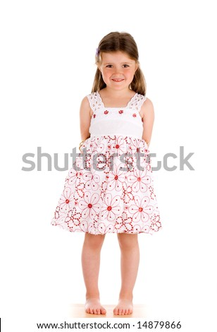 Little innocent girl on isolated background with hands behind her back - stock photo