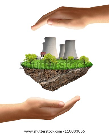 Little island with nuclear power plant - stock photo