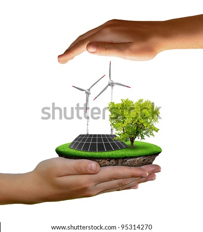 Little island with solar panel and wind turbines in the hands isolated on white - stock photo
