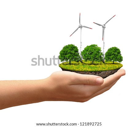 Little island with wind turbines and trees in the hands - stock photo