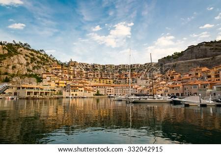 little italian marina with sailing boats - stock photo