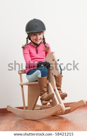 Little jockey and horse - rocking chair - stock photo