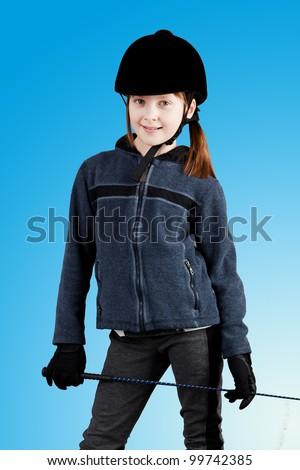 Little jockey  girl. Young rider. - stock photo
