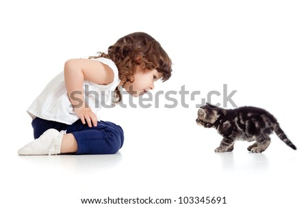 little kid and cat looking at each other on white background - stock photo