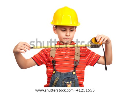 Little kid as a construction worker, with measuring tape