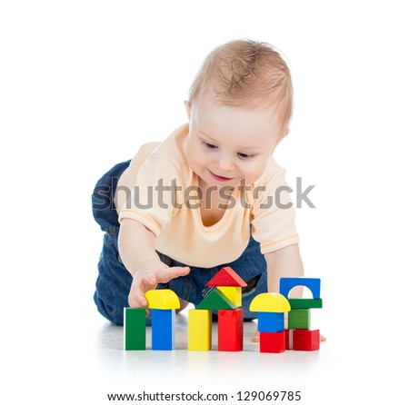 little kid boy playing with building blocks - stock photo