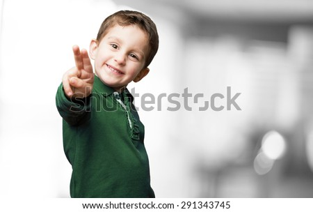 little kid doing victory sign - stock photo