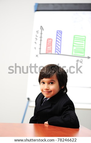 Little kid  drawing a  diagram on a whiteboard, future presentation - stock photo