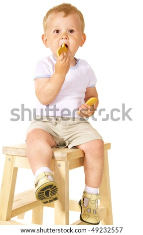 little kid eating cookies over white - stock photo