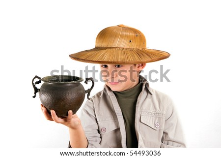 little kid explorer examining bronze age pot - stock photo