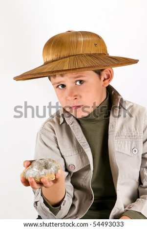 little kid explorer examining large Cristal / precious gem - stock photo