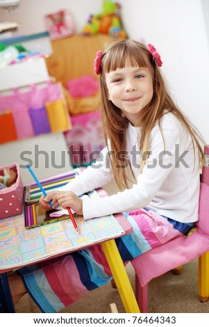Little kid girl painting at home - stock photo