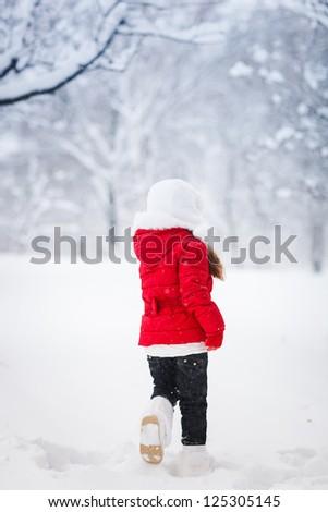 Little kid  girl running on snow - stock photo