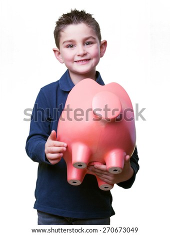 little kid holding a piggy bank