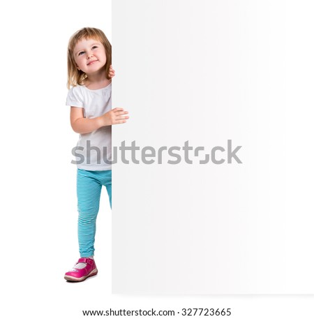 little kid holding big white blank for an advertisement - stock photo