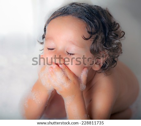 little kid in the bath tub - stock photo