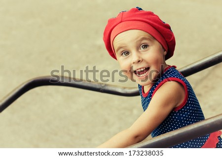 Little kid in the playing in the playground