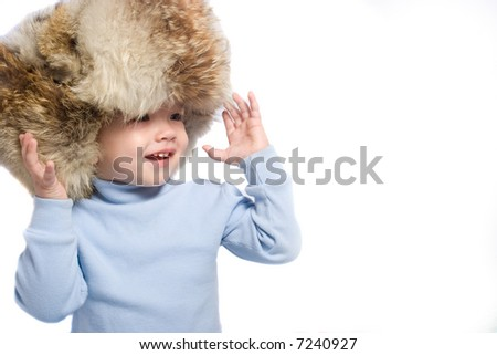 Little kid in winter hat - stock photo