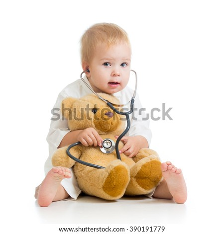 Little kid playing a doctor - stock photo