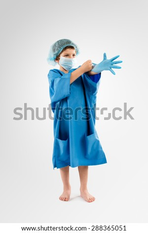 Little Kid playing Surgeon  - stock photo