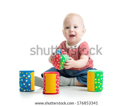 little kid playing with building blocks - stock photo