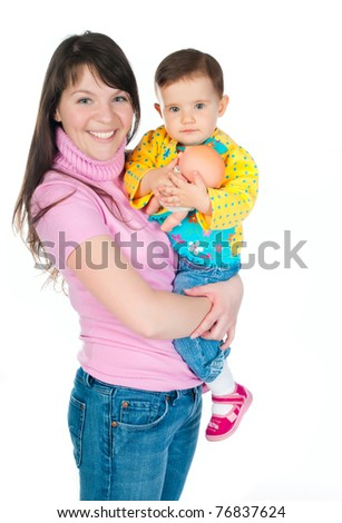 little kid playing with colorful toys on a white background - stock photo