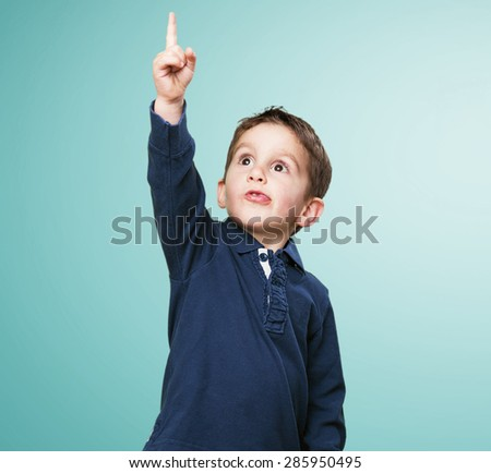 little kid pointing up - stock photo