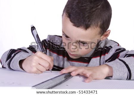 Little Kid Practices Writing on a Notebook