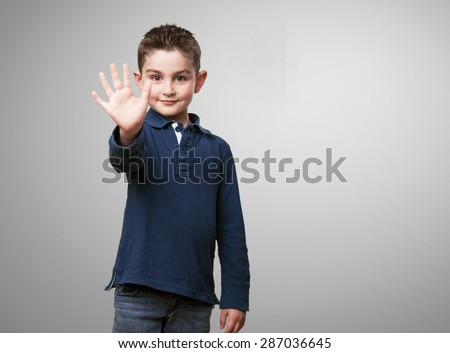 little kid showing 5 fingers - stock photo