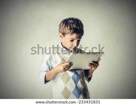 Little kid using a tablet  - stock photo