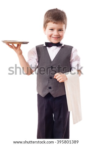 Little kid waiter standing with tray and towel, isolated on white - stock photo