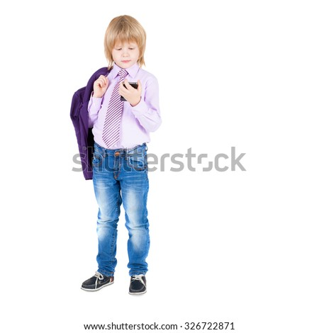 little kid wearing elegant shirt and tie speaking by telephone - stock photo