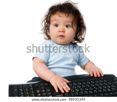 little kid with a computer keyboard on white - stock photo