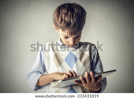 Little kid with a tablet  - stock photo