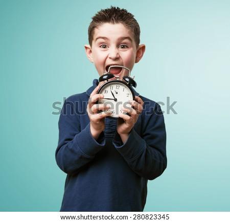 little kid with an alarm-clock - stock photo
