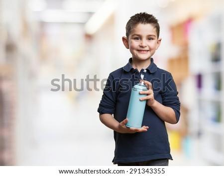 little kid with spray - stock photo