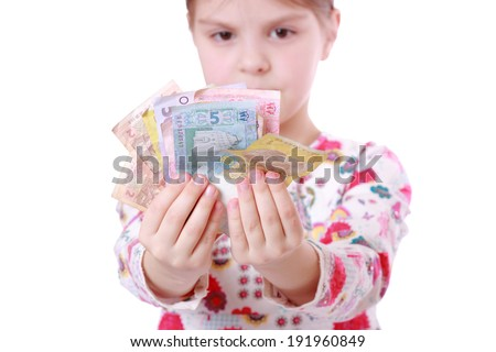 Little kid with ukrainian money