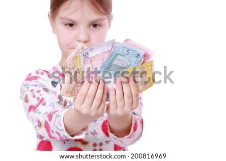Little kid with ukrainian money - stock photo
