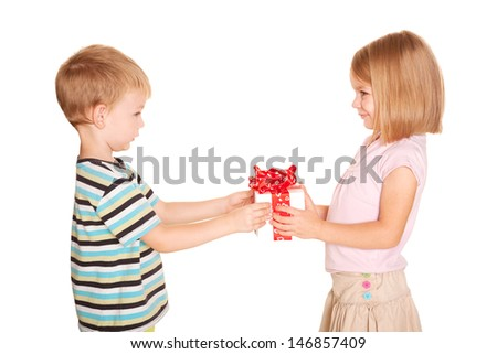 Little kids friendship and love. Little boy giving a little girl a gift. Present for a birthday, valentine's day or other holiday, ready for your text, logo or symbols. Isolated on white background - stock photo