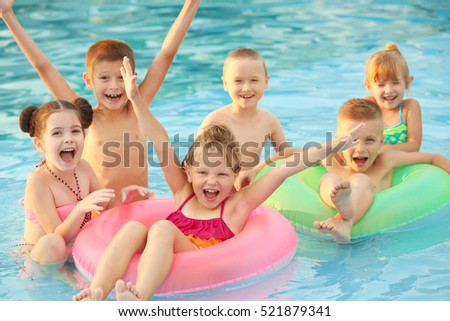 Kids Swimming kids swimming pool stock images, royalty-free images & vectors