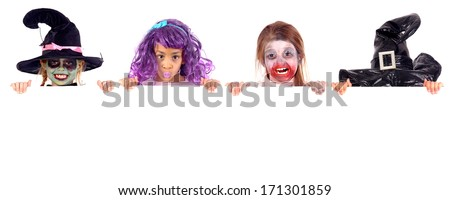 little kids on halloween with costumes - stock photo