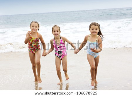 Little kids Playing at the Beach - stock photo