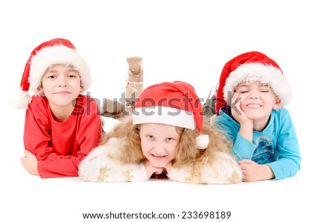 little kids with christmas hat isolated in white background