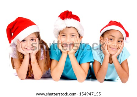 little kids with christmas hats isolated in white - stock photo