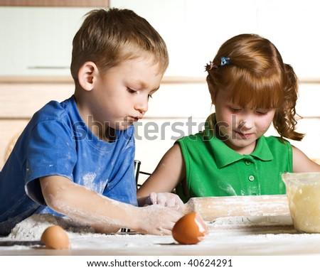 Little kitchen assistants - stock photo