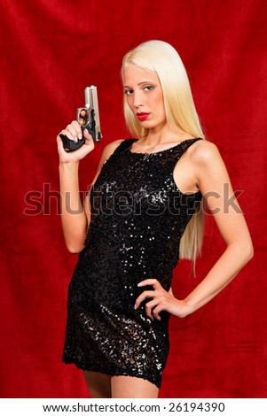Little Lady in Black poses with gun drawn - stock photo