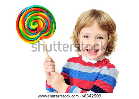 little laughing  girl holding big colorful lollipop - stock photo